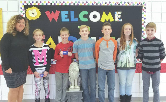 The Fairfield Local Schools recognized the students pictured at its first quarter Academic Awards for receiving perfect scores on the Spring 2017 Ohio State Test. Mya Hamilton received a perfect score in reading. Larkin Friend, Noah Allering, Reese Teeters, Makenna Colwell and Brayden Zimmerman all received perfect scores on the OST Math test. Pictured, from left, are Mrs. Miller, Fairfield Middle School principal; Mya Hamilton, fifth grade; Larkin Friend, sixth grade; Noah Allering, seventh grade; and Reese Teeters, Makenna Colwell and Brayden Zimmerman, eighth grade.