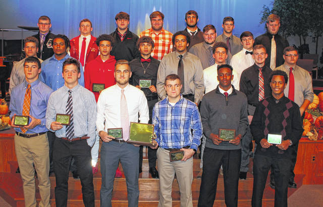 Selections for the First-team All-FAC football team pose for a picture on Thursday at Washington High School as part of the FAC fall sports awards banquet.