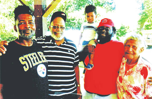 """Five generations of the Young family are shown in the photograph. Pictured, from right, are Rebecca Ford of Greenfield, David Young III, David """"Four"""" Young IV, David Young of Hillsboro, and David """"JR"""" Young Jr. The three youngest Youngs all live in the Columbus area."""
