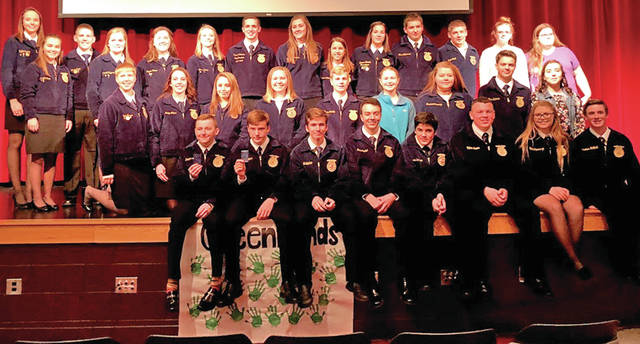 "On Nov. 16, the Hillsboro FFA Chapter held its annual Greenhand Night. At this banquet first-year members were presented with their Greenhand FFA Degree pin. This year, 23 members were recipients of this degree. In order to be eligible to receive the degree, members must be currently be enrolled in an agricultural class, have a satisfactory plan for a supervised agricultural experience, and exhibit knowledge the basic components of FFA such as FFA history, official colors, proper use of official dress, etc. The guest speaker was the Ohio State FFA President Ryan Mathews, who spoke to Greenhands and encouraged them to ""set goals, and plan to achieve them."" Later in the program, six Greenhand members presented the FFA Creed which outlines the basic beliefs of FFA members. These students were Jonathan Hatfield, Rhen Williamson, Nick Lewis, Kelcie Thornburgh, Garrett Fannin and Zinny Adams. The banquet also consisted of a meal prepared and provided by the Hillsboro FFA and the Grover family. The meal included pulled pork, macaroni and cheese, green beans and cookies. Pictured is the Hillsboro FFA Officer Team with Greenhand members."