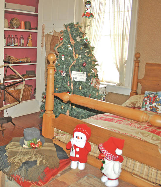 A room in the Highland House Museum is shown decorated for the holidays a year ago. The museum currently has extended hours and will host a Family Day this Saturday.