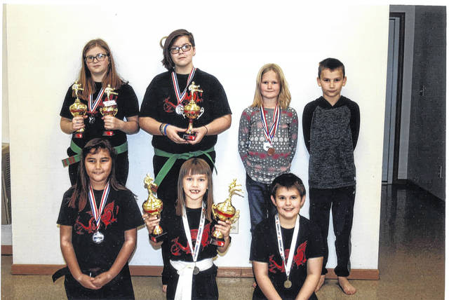 Members of the Cross County Bushido Karate Club pose for a picture with their trophies from the Toys for Kids Karate Tournament held at Lynchburg-Clay Elementary School.