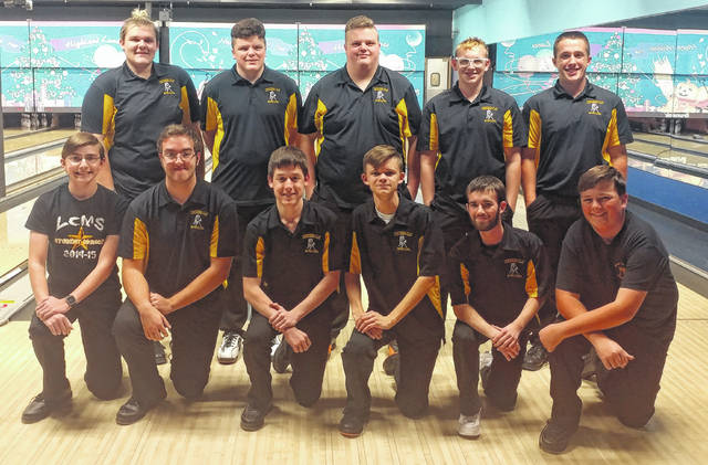 Lynchburg-Clay High School's boys bowling team poses for a picture on Monday at Highland Lanes prior to the start of their first match of the season.