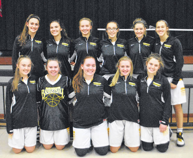 The Lynchburg-Clay Lady Mustangs basketball team poses for a picture prior to Friday night's SHAC preview game against the North Adams Lady Green Devils at North Adams High School in Seaman.
