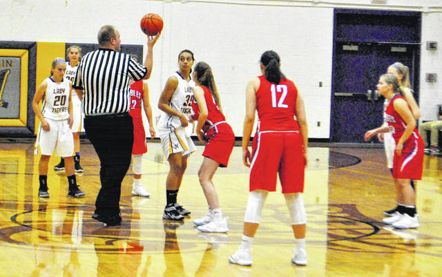 Mikenzie Coleman prepares for the jump ball on Saturday at McClain High School at the beginning of the Lady Tigers' foundation game in memory of John Wend.
