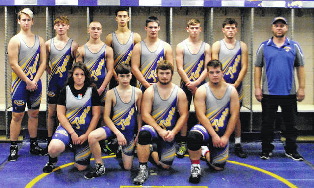 The McClain High School coed wrestling team poses for a team picture in the field house at McClain High School in Greenfield.