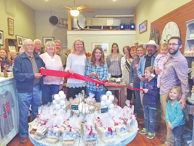 Pictured holding the ribbon are Leesburg Mayor Freddie Snyder; Tracy Evans from Grow! Highland County; Tristian Abt, owner; Landon Abt; Bryant Abt, (owner); and Camdyn and Emersyn Abt. Also pictured are members of the Leesburg Village Council and local contributing vendors.
