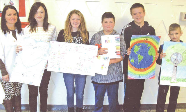 The Lynchburg Lions Club and Lions Club International sponsored their annual Peace Poster Contest this fall. The clubs encourage middle school students to develop a special poster on a theme related to promoting world peace. A total of 87 students participated in the contest. Ms. Free supervised the contest. Five winners were selected and they were given certificates and cash prizes. All participants were recognized. The top five winners and the families will be invited to a special dinner later this winter at the Lynchburg Lions Club building to honor them. The top five winners this year, in order, were Logan Warner, Samantha Merry, Americo Brioli, Blake Eyre and Taylor Stroop. All are sixth grade students at Lynchburg-Clay Middle School. Warner's award-winning poster was submitted to the district finals. Each Lions Club is encouraged to submit an entry from its local school. There are 64 Lions Clubs in district 13-OH6 and the Lynchburg Lions club is proud to sponsor Warner in the district contest. Pictured, from left, are Free, Stroop, Merry, Warner, Brioli and Eyre.