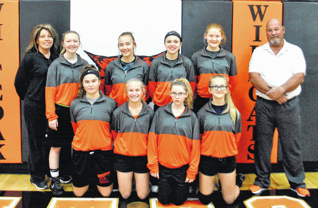 The Whiteoak Lady Wildcats varsity basketball team poses for a picture in the gymnasium at Whiteoak High School prior to preseason practice. Front row (l-r): Cylee Bratton, Sydnie Raines, Sha Van-Lieu and Kara Ward. Back row (l-r): Assistant coach Nicholle Stratton, Hailey Montieth, Megan Botts, Courtney Gross, Jordan Griggs and Head coach Steve Smith. Not pictured: Ariel Farrahay.