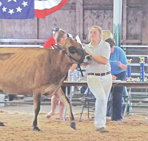 Mowrystown FFA Member Audrey Ferguson was recognized Oct. 26 at the annual awards luncheon for placing Top 10 and for a Gold Emblem rating in the Dairy Handlers CDE at the 90th National FFA Convention and Expo. The Dairy Handlers CDE is a competition for FFA members to show how they represent the dairy cow in the best way possible.