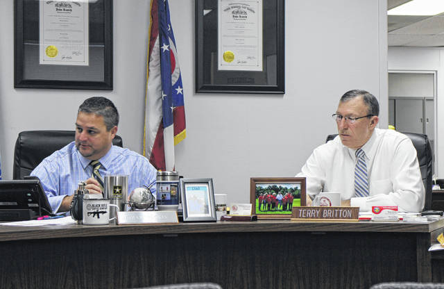 Highland County Board of Commissioners President Shane Wilkin, left, sits in session with commissioner Terry Britton during a Wednesday commissioners meeting.