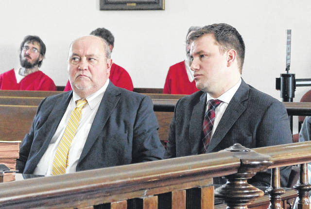 Seth Parshall, right, sits in court on Wednesday with defense attorney Bruce Wallace.