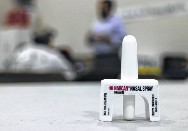 Shown is one dose of Narcan, a drug that reverses the effects of a drug overdose.
