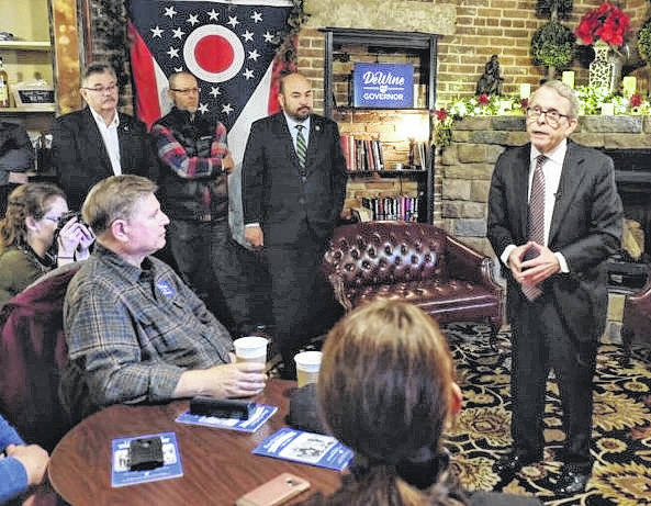 Ohio Attorney General and Republican gubernatorial candidate Mike DeWine, standing at right, visited Kava Haus in Wilmington on the third day of a three-day campaign trip. Also shown standing, center, is Speaker of the Ohio House Cliff Rosenberger.