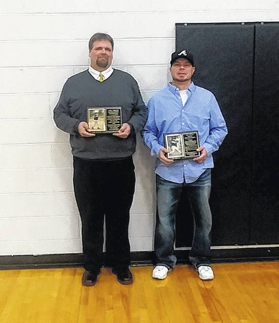 Aric Fiscus (left) and Joe Wells pose together on Friday December 21 at Lynchburg-Clay High School after being inducted into the Lynchburg-Clay High School Athletic Hall of Fame.