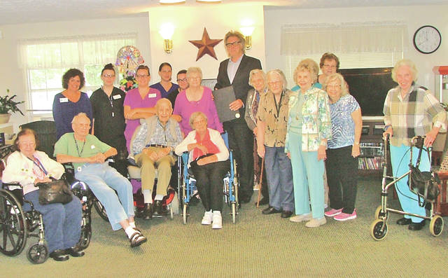 """Bell Gardens has been recognized by Senior Advisor.com as one of the top providers for senior living for 2018 in Ohio. """"This is extremely satisfying, said Michael Bradford, Bell Gardens executive director. """"This award validates the hard work, dedication and service that Bell Gardens staff has provided to seniors in the area. Senior Advisor rates all senior living facilities across the country and evaluates practices as well as reviews for residents and family members. This award is given annually to senior living providers and there is very strong competition in the area that Bell Gardens services. I am extremely proud of all the staff here at Bell Gardens Place, and thankful for all the hard work they do every day."""" Bell Gardens staff members and residents are pictured earlier this year during a proclamation signing."""
