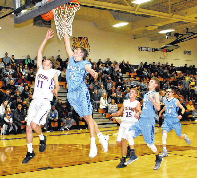 Dakotah Duncan attempts a layup on the fast break as Preston Sykes of Adena contests and Garrison Banks of McClain along with Warriors Jacob Shipley and Jarrett Garrison trail the play.