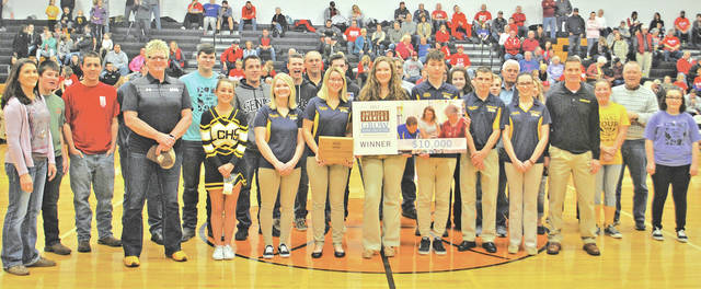 Those who took part in a $10,000 check presentation at a Lynchburg-Clay basketball game last weekend are pictured.