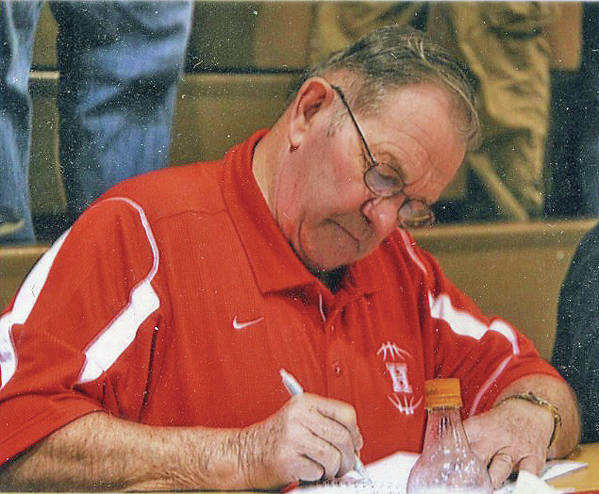 Galen Neal is pictured keeping the scorebook for Hillsboro at an away game. At the suggestion of the late George Williams, he always wore a black and white striped official's shirt for home games.