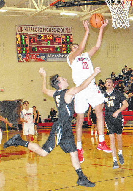 Hayden Haines rises above the Miami Trace defender on Friday night in Hillsboro where the Indians took on the Panthers.