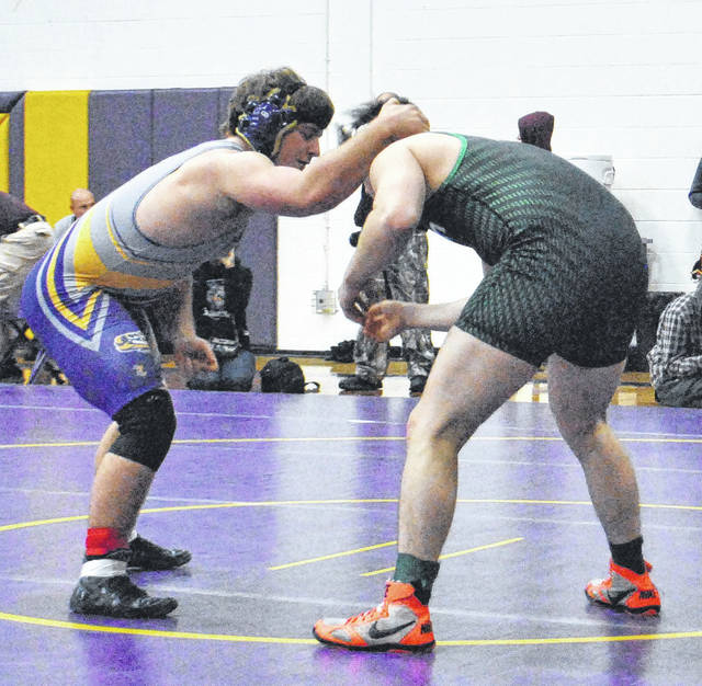 Kyler Trefz attempts to gain control of Mason's John Doran during their first round match at McClain High School on Saturday as part of the Fourth Annual McClain Tiger Invitational.