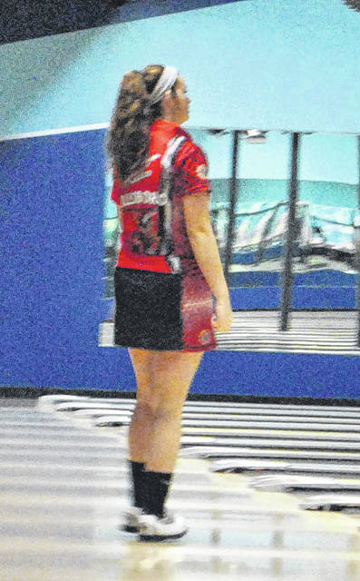 Madalyn Miller watches to see the results of her shot on Monday at Highland Lanes in Hillsboro where the boys and girls teams from the five county high schools took on one another in high school bowling action.