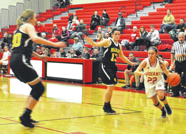 Madi Marsh drives baseline against as two Paint Valley defenders converge Thursday as Hillsboro High School