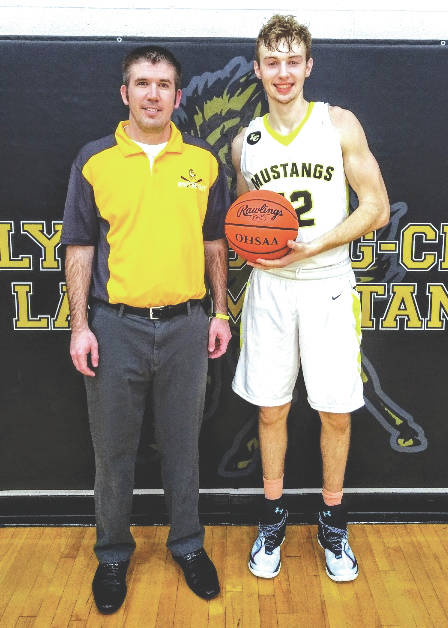 Lynchburg-Clay senior Eric McLaughlin, left, is pictured with Mustang coach Matt Carson after scoring his 1,000th point last Saturday.