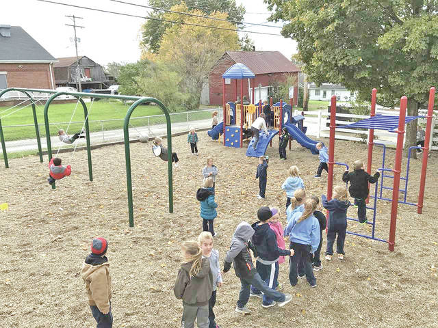 Students at St. Mary Catholic School in Hillsboro enjoy their new playground equipment.