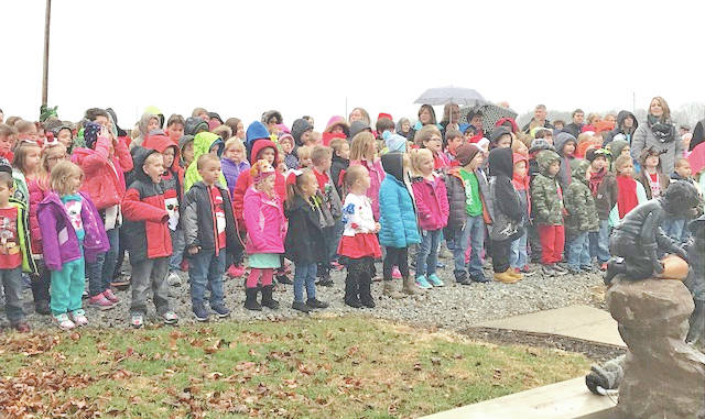 Rainsboro Elementary students and staff are shown Monday afternoon as they sang Christmas carols at the home of former Rainsboro teacher Lois Peabody McDorman.