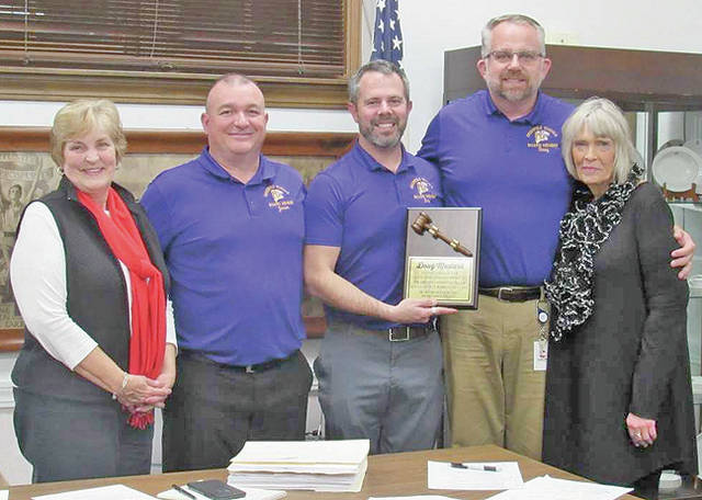 Exiting Greenfield School Board member Doug Mustard (second from right) is pictured with school board members (l-r) Sandy Free, Jason Allison, Eric Zint and Marilyn Mitchell. The board presented Mustard with a plaque thanking him for his years of service on the board.