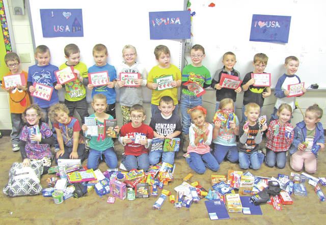 Students in Erin Walter's kindergarten class at Lynchburg-Clay Elementary recently collected supplies to send to military personnel who are currently deployed. The class learned about the sacrifices that people in the military make to keep others free and safe. The names of four servicemen were then nominated to receive packages that included many treats, activities and hygiene products, as well as handmade cards and signs. The packages were sent to Italy, Iraq and Japan. Members of the class are pictured.
