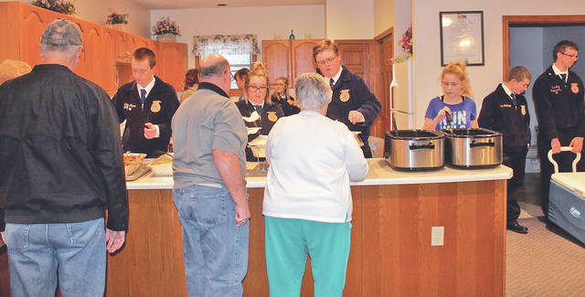 On Nov. 21 the Mowrystown FFA Chapter held its annual Community Thanksgiving Dinner at the Fairfax United Methodist Church and Mowrystown Church of Christ. For this dinner, members cooked and prepared turkey donated by Tammy Hauke and Jolene Bush, mashed potatoes, corn, green beans, homemade stuffing, rolls donated by Ponderosa, pumpkin rolls donated by Mary Leston, desserts and drinks. With both the churches combined the chapter served 210 plates. The Mowrystown FFA Chapter would like to thank all the members that helped, the parents that assisted, and all the community members that came.
