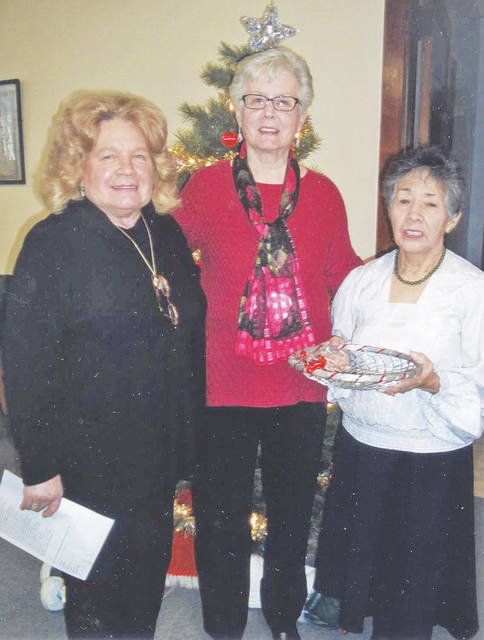 From left, Toy Fender, Eleanor Williams and Teresa Cudkowitz were responsible for all the fun at the December meeting of the Hillsboro Woman's Club.