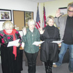 Three take oath for city council