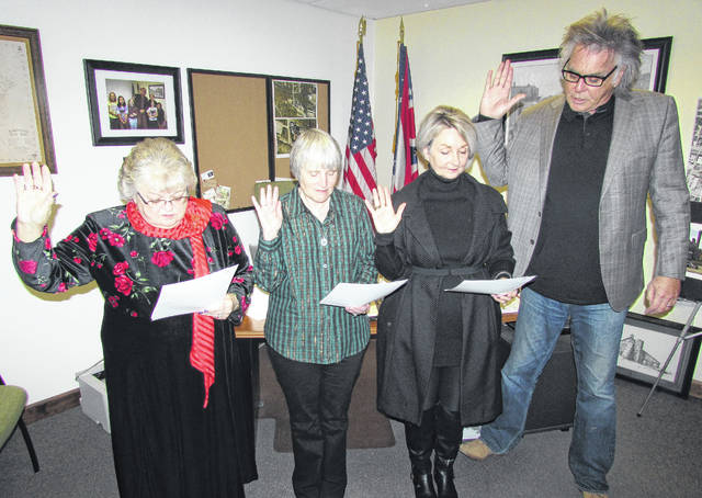 From left, Claudia Klein, Wendy Culbreath and Ann Morris take the oath of office for Hillsboro City Council administered by Mayor Drew Hastings on Thursday at the mayor's office. Klein and Morris are returning for second terms on council, while Culbreath will begin her first term in January. Other council members will be sworn-in at later dates.