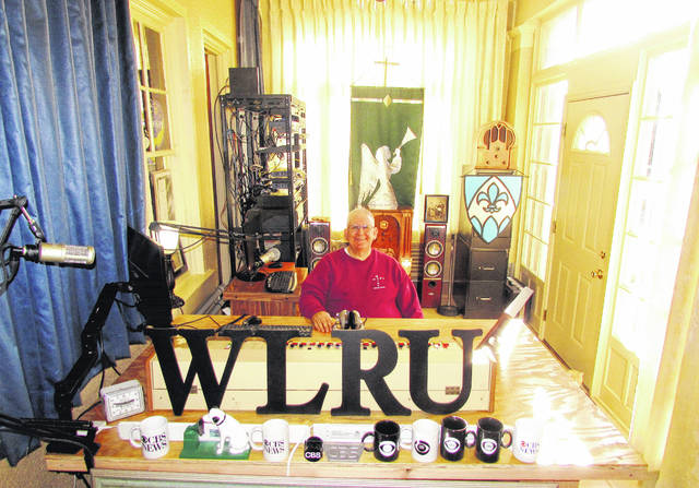 Father Mike Paraniuk is shown in the large studio space recently completed at St. Mary Catholic Church in Hillsboro, where WLRU broadcasts Christian music and teachings, along with a mix of local programming. Beginning this month, the station will broadcast Hillsboro High School bowling.