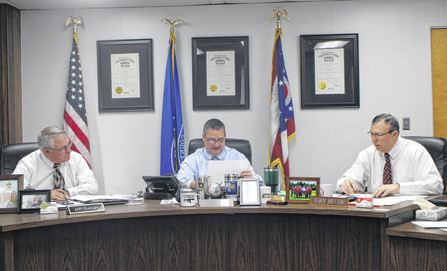 From left, Highland County Commissioners Jeff Duncan, Shane Wilkin and Terry Britton discuss business items during a commissioners meeting on Wednesday.