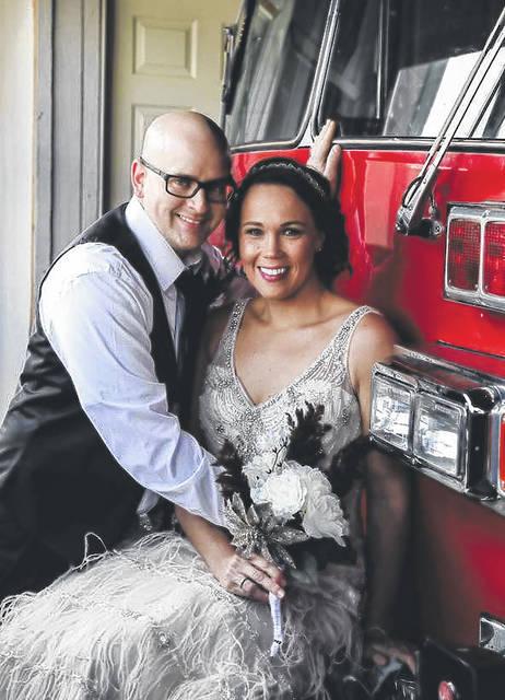 Michael and Kelly Sowards are shown in front of a Paint Creek Joint EMS/Fire District tanker truck at the old fire house on North High Street in Hillsboro.