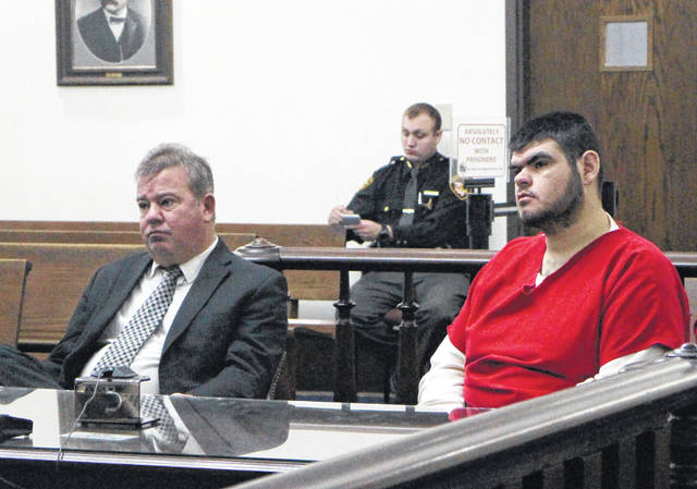 Nathan Day, right, sits in court Friday morning with defense attorney Rich Federle.