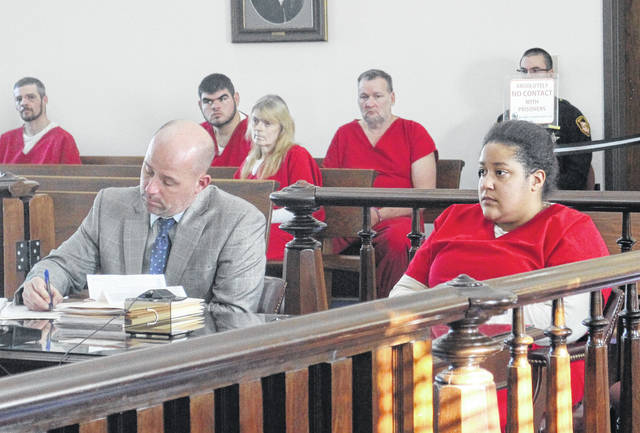 Sabrina Banks, right, sits in court with defense attorney J.D. Wagoner.