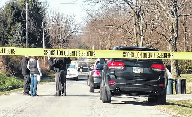 Police tape blocks off a crime scene on Powell Road Friday morning. Authorities are conducting an investigation into a double shooting that happened in the area.