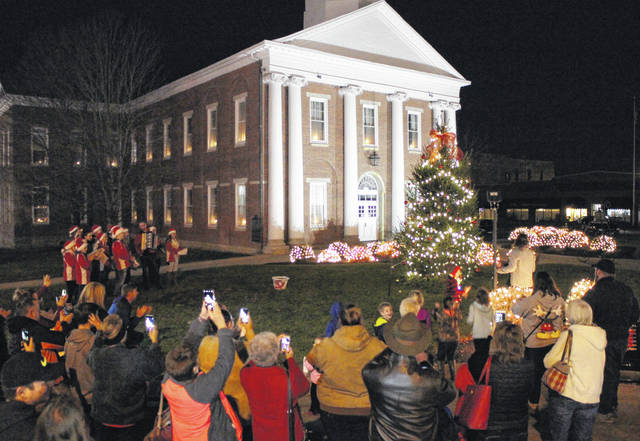 A crowd of people gathers in front of the Highland County Courthouse in Hillsboro Friday evening for a tree-lighting ceremony.