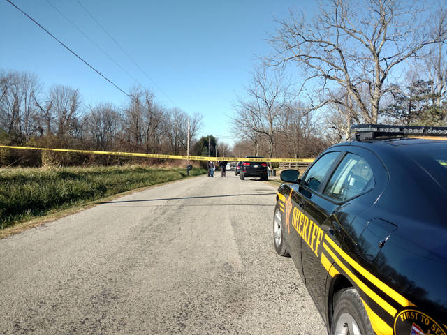 Authorities investigate a set of apparently fatal shootings on Powell Road near New Vienna Friday morning.
