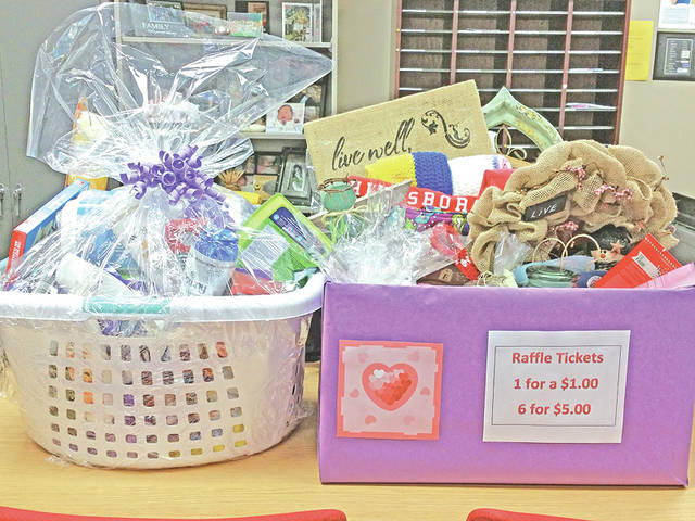 Some of the items being raffled off by Hillsboro High School to benefit the family of late student Megan Rust are shown in these two baskets.