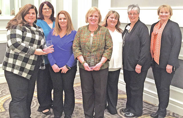 Pictured at the Ohio Association of Area Agencies on Aging Annual Conference during the Partnership of the Year Award presentation are, from left, Mandy Kenz, Chillicothe VA Medical Center; Merritt Sessor, Area Agency on Aging District 7; Keisha Kelley, Chillicothe VA Medical Center; Dr. Christine Raber, Shawnee State University; and Chelsey Wemmer, Nina Keller and Kaye Inoshita from the Area Agency on Aging District 7.