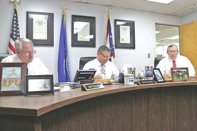 From left, Highland County Commissioners Jeff Duncan, Shane Wilkin and Terry Britton conduct business during a commissioners meeting on Wednesday.