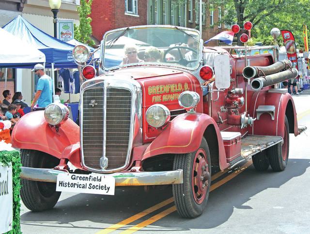 The Greenfield Historical Society's Ahrens Fox firetruck was driven in the Greene Countrie Towne Festival Parade last July. The truck is an example of the historical society's preservation of Greenfield history made possible by the support of community.