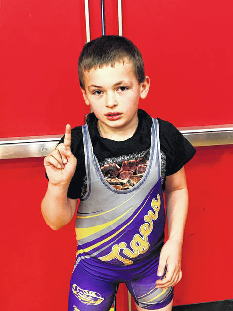 Josh Smith holds up one finger to signal that he is number one following a championship performance at London High School on Sunday in a COBYWA wrestling tournament.