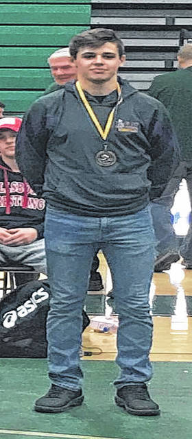 Keegan Rawlins poses with his tournament medal after winning the 152 pound title at the John Deno Wrestling Invitational held at Athens High School on Saturday. Rawlins also became McClain High School's all-time wins leader with 138 career victories.